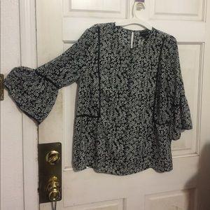 All poly flounce sleeve floral print blouse.